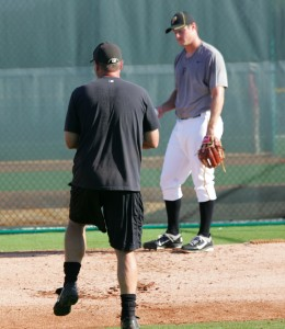 Jim Benedict instructing Gerrit Cole in instructs during the 2011 season.