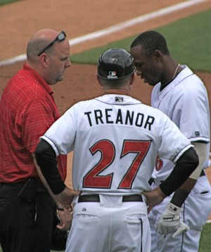 Trainer Bryan Housand and manager Dean Treanor talk with Starling Marte after Marte was hit on the right hand by a pitch.