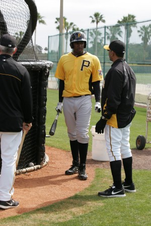 Josh Bell talking with former Pirates first baseman and his 2013 West Virginia hitting coach, Orlando Merced.