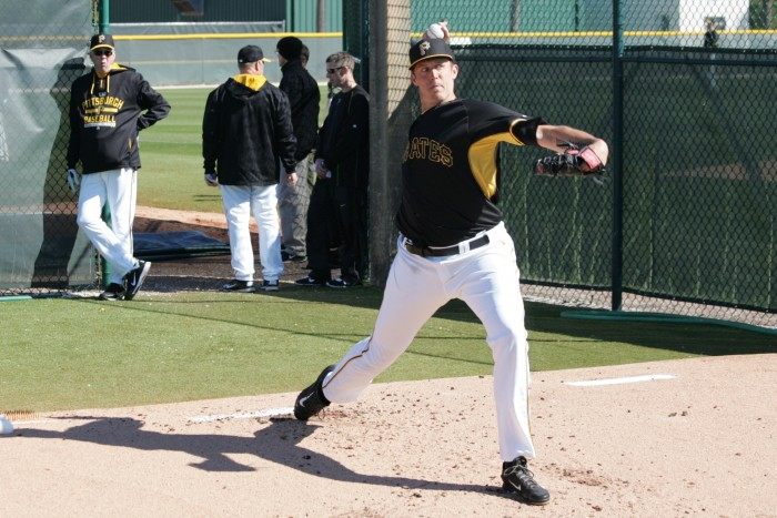 John Holdzkom throwing a bullpen with Kent Tekulve watching on.